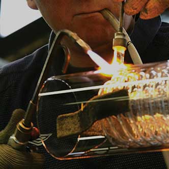 man glass blowing
